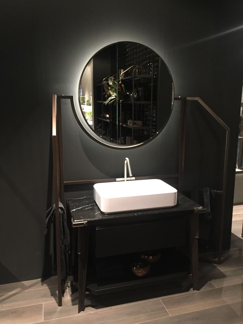 Modern bathroom vanity with black marble on top
